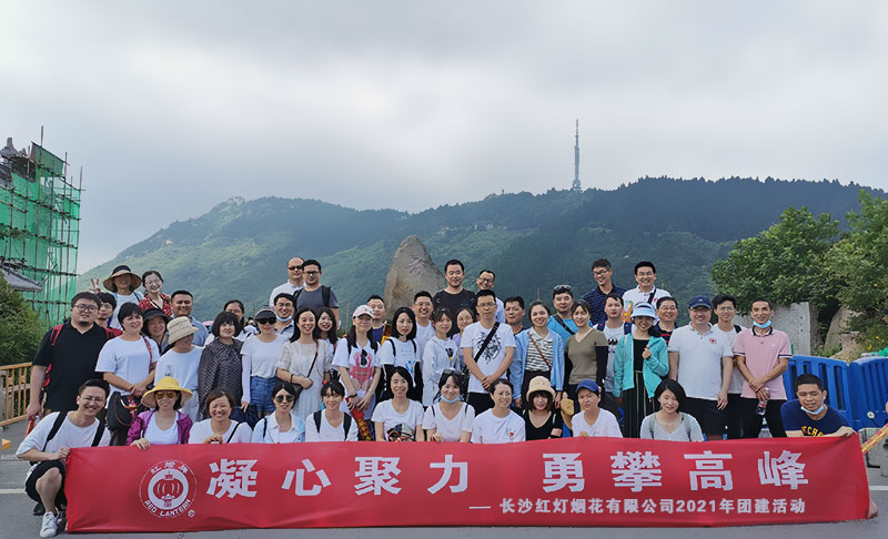 Team members take a group photo after climbing halfway up the mountain